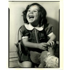 Elisofon, Eliot. Young Girl   & Doll  Laughing