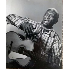 Abbott, Berenice. Leadbelly (Huddie Ledbetter )With His  Guitar LL 30