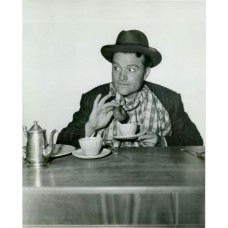 Bull, Clarence Sinclair.  Red Skelton Dunking A Doughnut for his new movie,  Whistling In Brooklyn