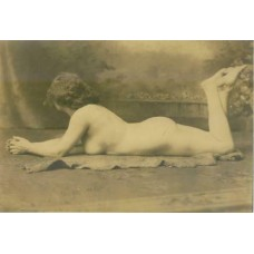 Nude. Reclining Nude With Legs Up. Circa 1900.   4  1/2 x 6 1/2 inch silver print.