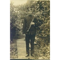 RPPC. Young Man In Band Uniform Holding Clarinet