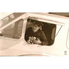 French Aviator Leaning From Window Of  His  Plane Holding Flowers