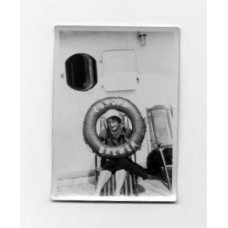 Snapshot, German . 1932. Woman Looking Through Europa Life Preserver.
